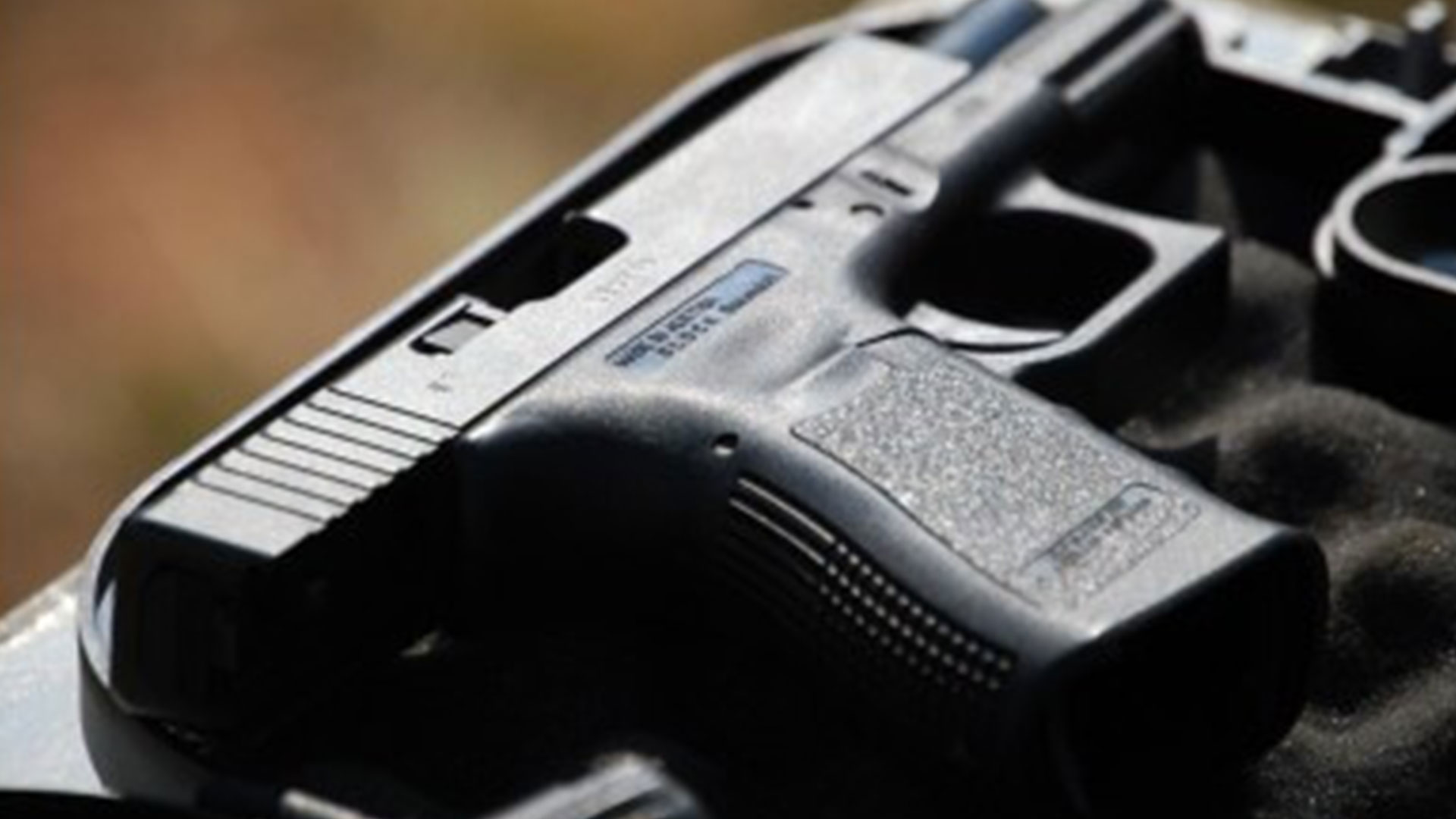 Security employee shot chasing down alleged looters